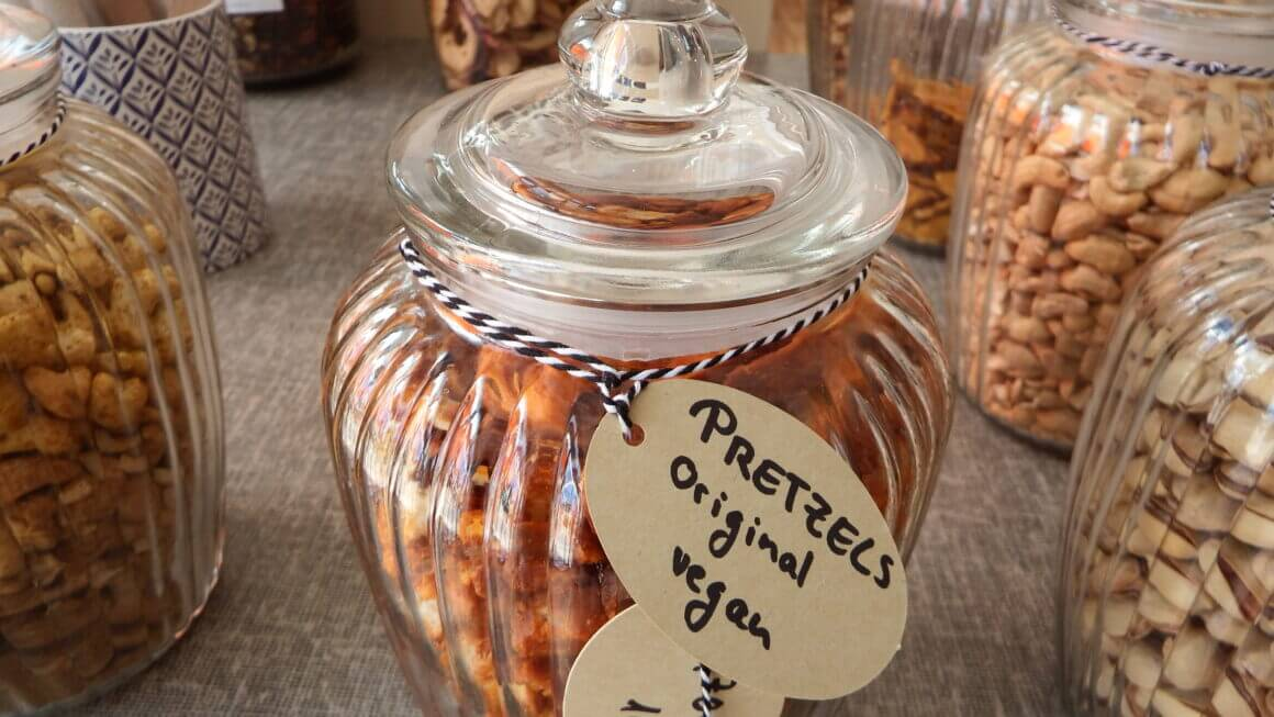 A glas container with vegan prezels