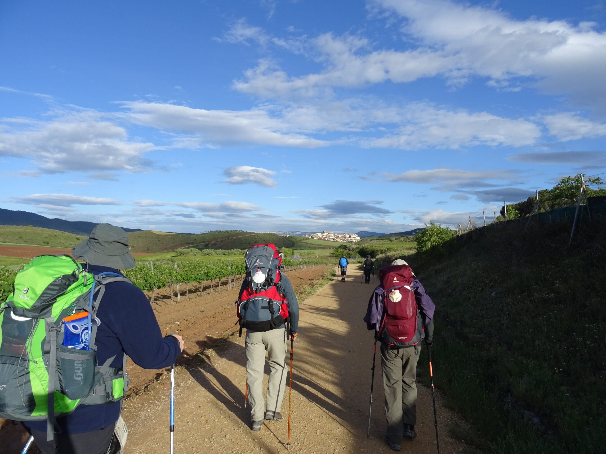 Three hikers on their way to Santiago de Compostela.