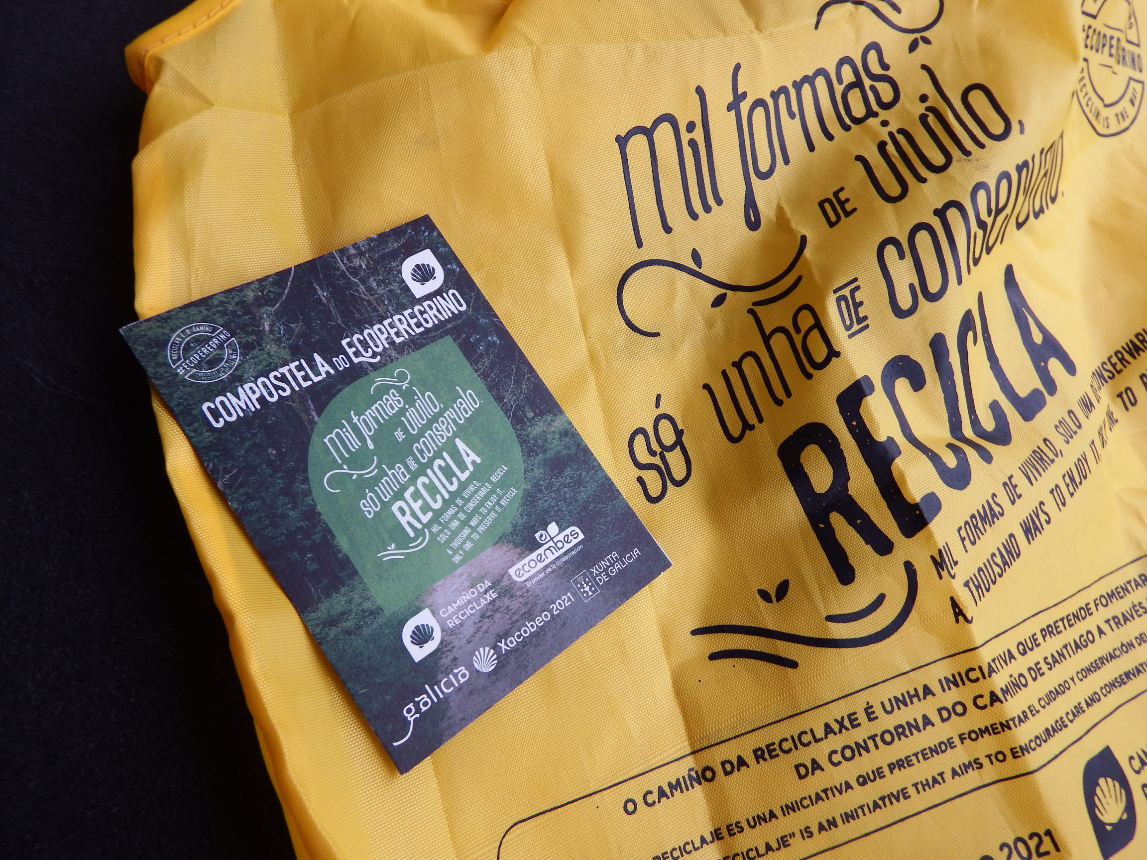 Yellow recycling bag and a stamp card.