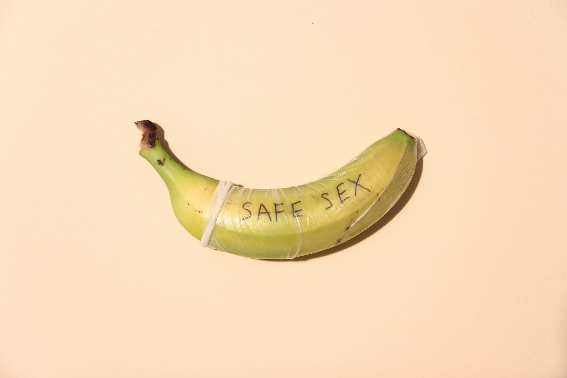 """Banana with a condom on saying """"safe sex"""""""