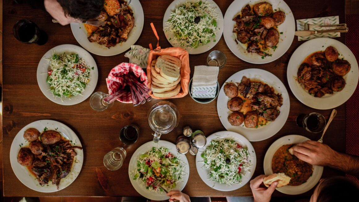A table from above full with plates and food.